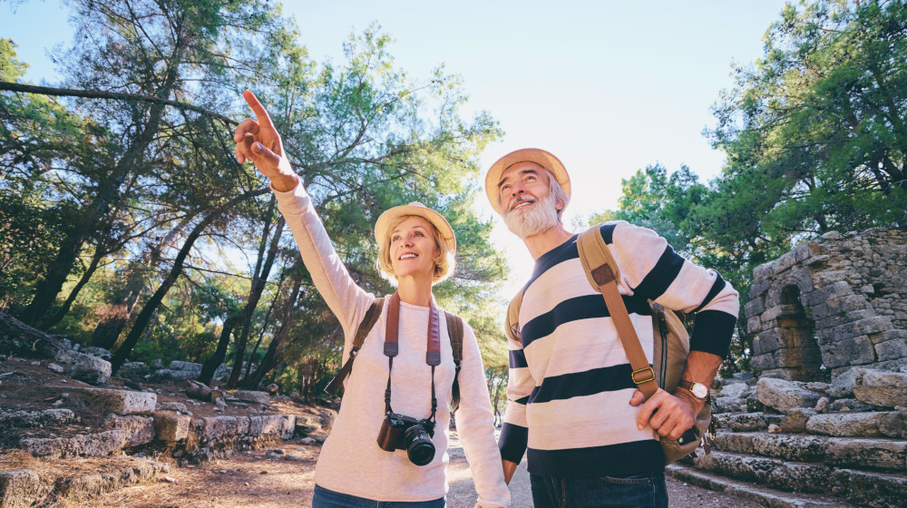 senior-couple-walking-together-sightseeing-travel